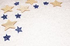 Christmas background, with gold and blue glitter stars and snow. Sophisticated, luxury - copyspace stock photos