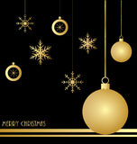 Christmas background with gold decorations. On black background Stock Photo