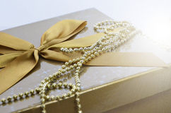 Christmas background. Christmas gold present with bow Stock Image