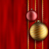 Christmas background - gold and red balls. On red background Royalty Free Stock Photography