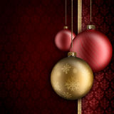 Christmas background - gold and red baubles Stock Photos