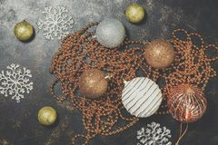 Christmas background, gold and silver balls, beads, snowflakes on a rustic background. Beautiful vintage decorations for the. Christmas tree. Top view, flat lay stock photos