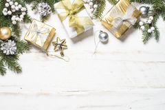 Christmas background with gold and silver decorations on white. stock photo