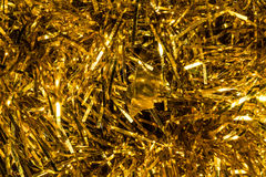 Christmas background with gold tinsel. Holiday design Royalty Free Stock Images