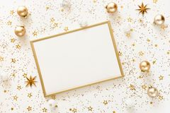 Christmas background from gold and white Christmas decorations on white table. Xmas composition of New Year`s Christmas balls. Winter holiday concept.Flat lay royalty free stock photography