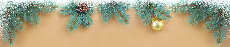 Christmas background with golden ball and fir tree branches. Stock Photo