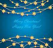 Christmas background with golden baubles and stars Stock Photography