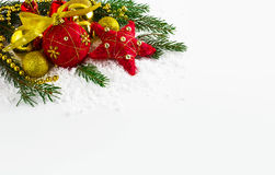 Christmas background  with golden beads and fir branches Royalty Free Stock Photography