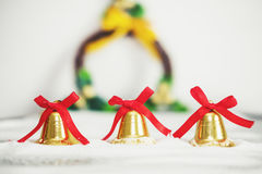 Christmas background, golden bells with red ribbon Royalty Free Stock Photos