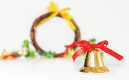 Christmas background, golden bells with red ribbon Stock Image