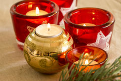 Christmas background with a golden candle Stock Photography