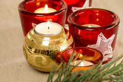 Christmas background with a golden candle Royalty Free Stock Photo