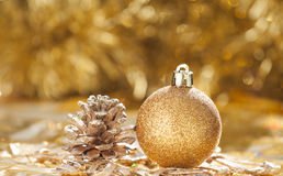 Christmas background with golden christmas ball and cone Royalty Free Stock Image