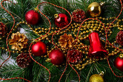 Christmas background with golden Christmas beads and red ornamen Stock Photography