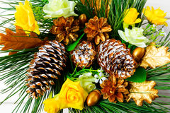Christmas background with golden decorated pine cones and silk r Royalty Free Stock Photo