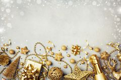 Christmas background with golden gift or present box, champagne and holiday decorations top view. Greeting card. Flat lay style. Christmas background with golden royalty free stock photography
