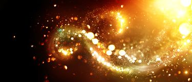 Christmas background. Golden glittering stars swirls. Over black background royalty free stock image