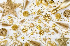 Christmas background with golden holiday decorations top view. Greeting card. Flat lay style stock photo