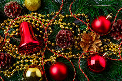 Christmas background with golden pinecone and red ornaments Royalty Free Stock Photos