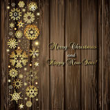 Christmas background with golden snowflakes and lights Royalty Free Stock Photo