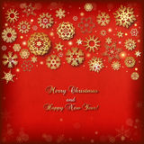 Christmas background with golden snowflakes and lights Stock Images