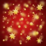 Christmas background with golden stars. Red blurry christmas background with golden stars stock illustration