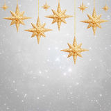 Christmas background - golden stars. On silver background stock photo