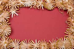 Christmas background with golden straw stars on a red background Royalty Free Stock Photo