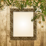 Christmas background with a gorgeous garland and frame for photo Royalty Free Stock Image