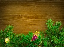 Christmas background. Green branches of spruce on dark wood background. Place for text Stock Photos