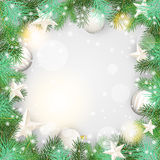 Christmas background with green branches and white ornaments Royalty Free Stock Photo