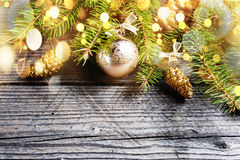 Christmas background. Green Fir with pine cones, gold snowflakes, ball Royalty Free Stock Photography