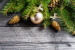 Christmas background. Green Fir with pine cones, gold snowflakes, ball Royalty Free Stock Photo