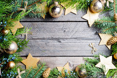 Christmas background. Green Fir with pine cones, gold snowflakes, ball Royalty Free Stock Image