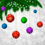 Christmas background with green fir tree branches. And colorful balls. Bokeh background Royalty Free Stock Images