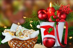 Christmas background, greeting card with burning candle and gingerbread cookies Stock Photos