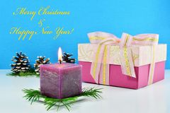 Christmas background, greeting card with burning candle Stock Photo