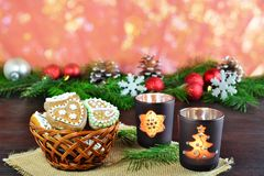 Christmas background, greeting card with burning candle and gingerbread cookies Stock Photo
