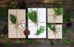 Christmas background with hand crafted gifts, presents  on rustic wooden table. Overhead, flat lay, top view Royalty Free Stock Photography