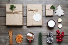 Christmas background with handmade present gift boxes and rustic decoration on vintage wooden board. royalty free stock photos