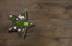 Christmas background with a handmade star of wood and green deco Royalty Free Stock Photo