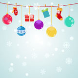 Christmas background with hanging gift boxes, socks. And christmas balls on light blue Stock Images