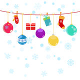 Christmas background with hanging gift boxes, socks. And christmas balls on white Royalty Free Stock Photography