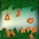 Christmas background with hanging gingerbreads. And fir branches Royalty Free Stock Photos