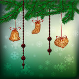 Christmas background with hanging gingerbreads. Garland of chocolate dressage and fir branches Stock Photo