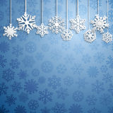 Christmas background with hanging snowflakes Stock Images