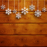 Christmas background with hanging snowflakes on wooden planks Stock Photography