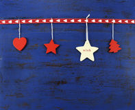 Christmas background with hanging wood decorations on dark blue vintage wood. Stock Image