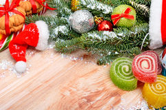 Christmas background, hat Santa Claus, pine twig, biscuit and je Royalty Free Stock Photography