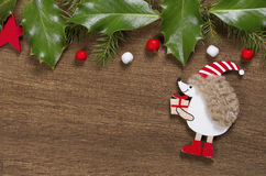 Christmas background with hedgehog and Holly leaves Stock Photography